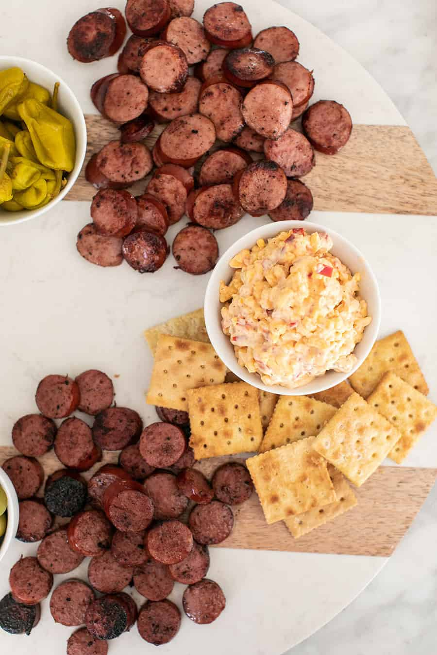 Pimento cheese and sausage on a platter.