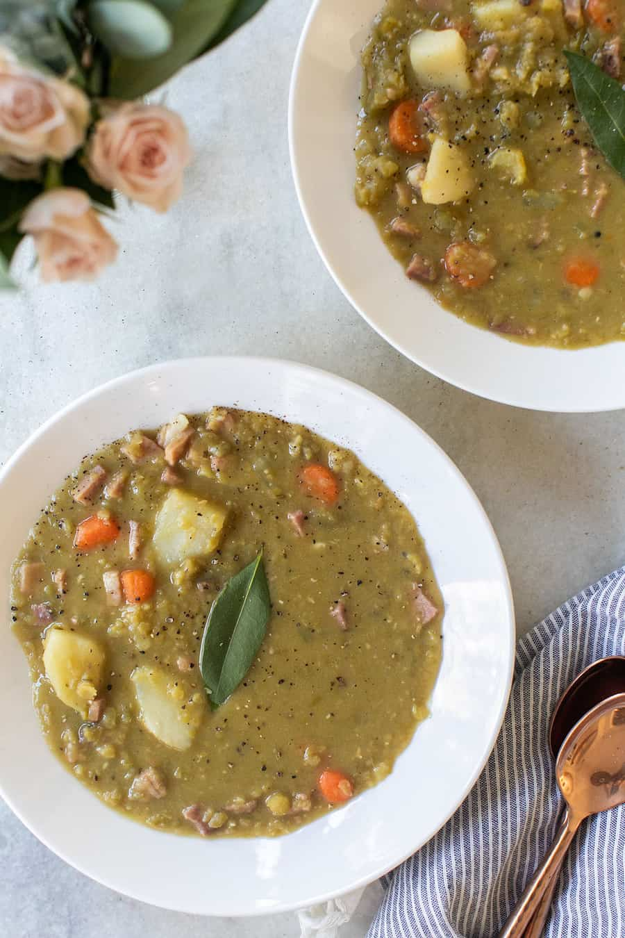 Split pea soup with bay leaf, potatoes and carrots.