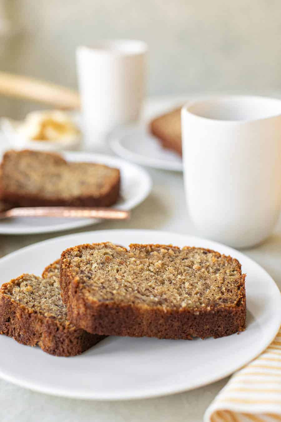 Moist and delicious banana bread on a white plate