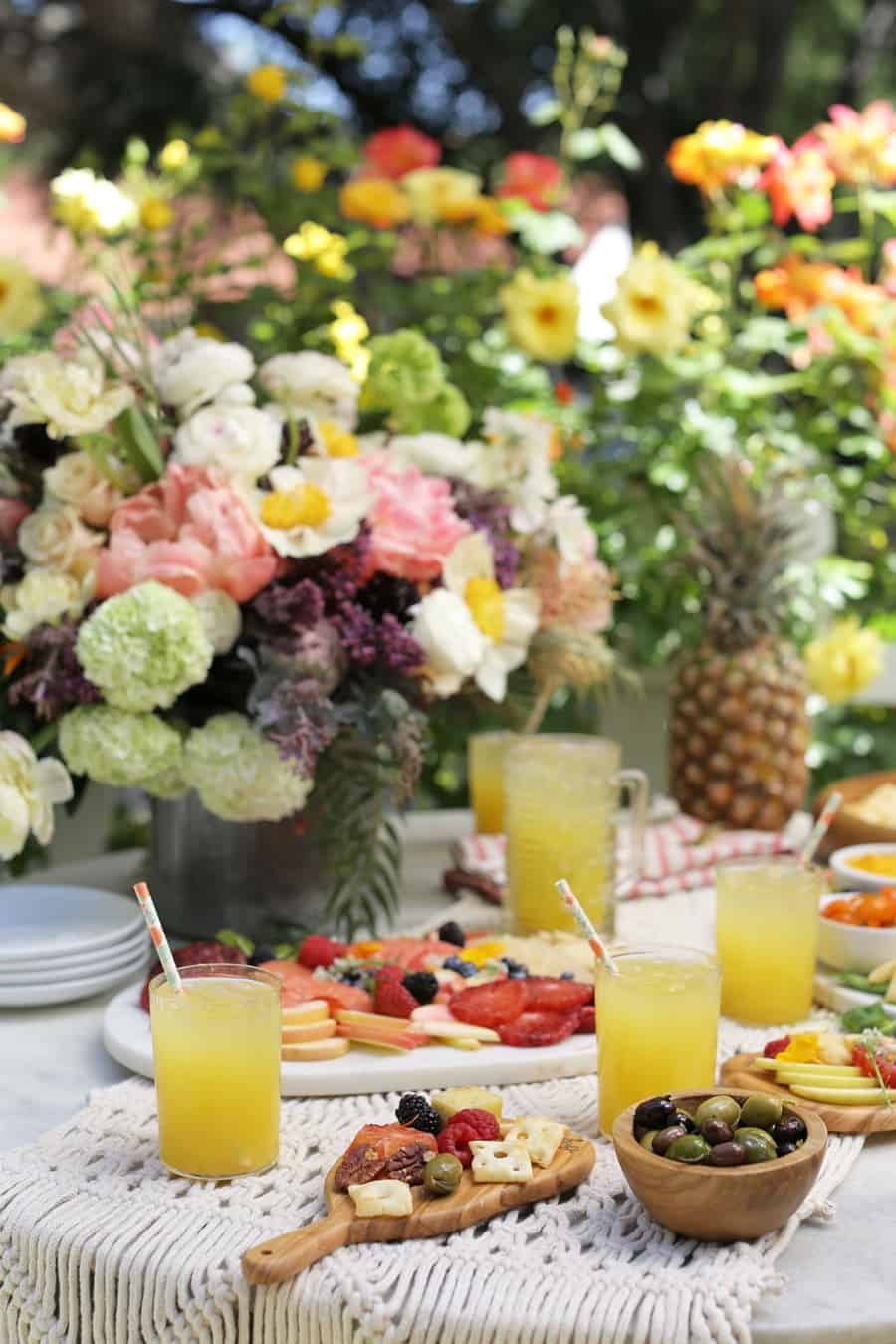Garden party with flowers, drinks and cheese boards