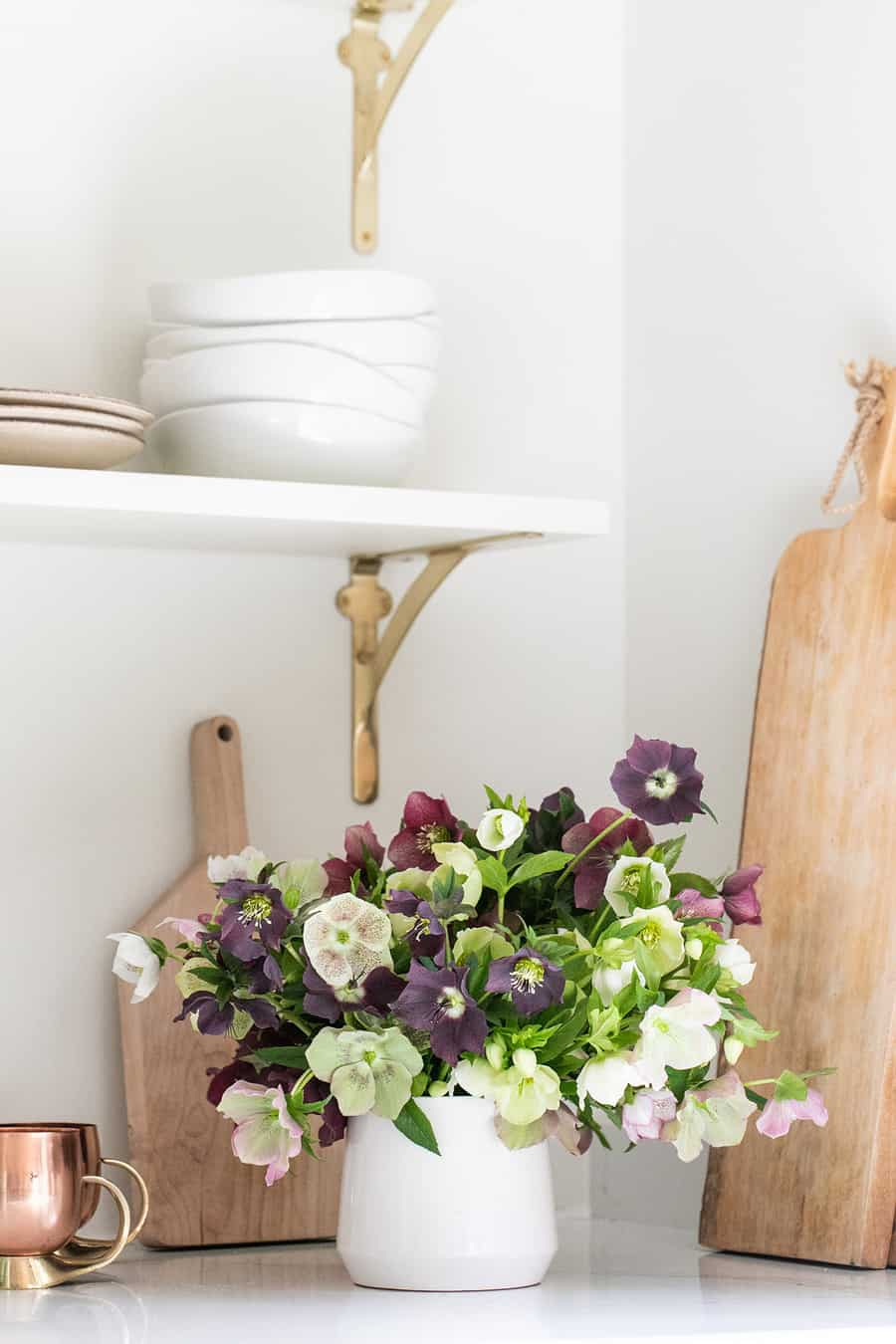 Hellebore in a white vase in a kitchen