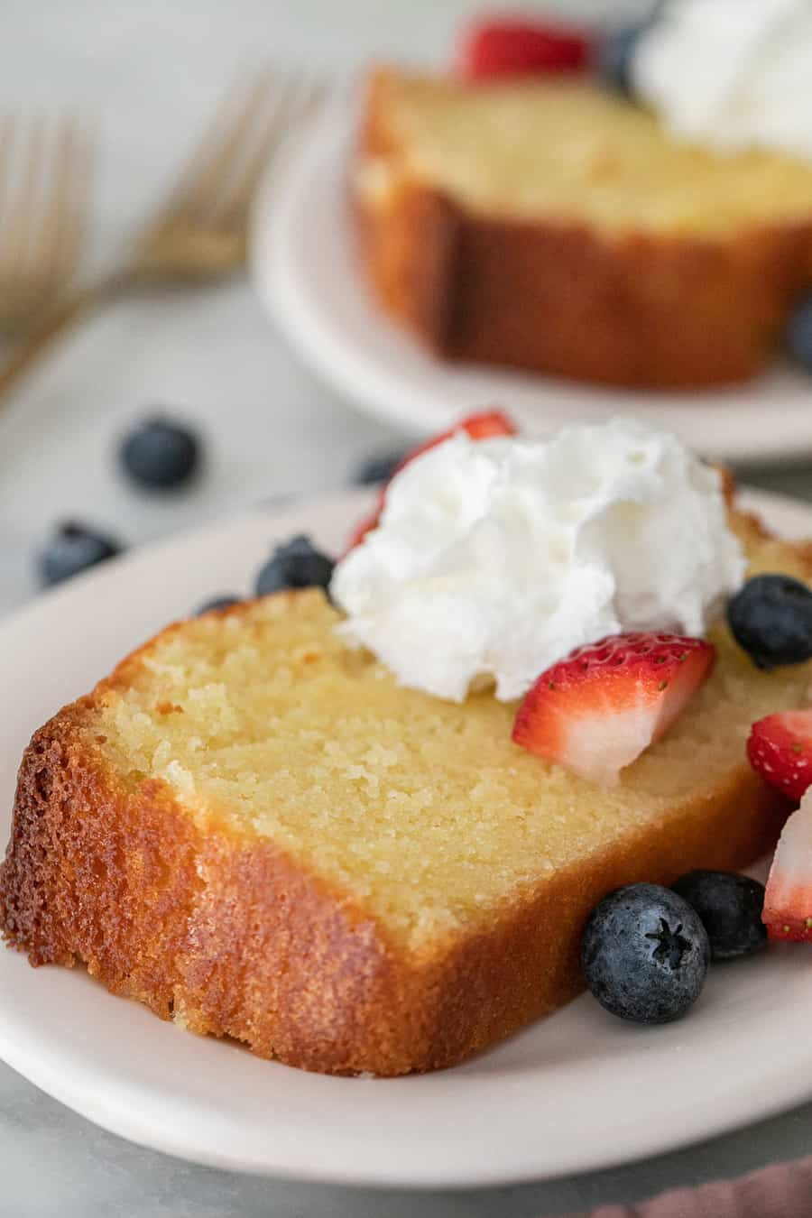 moist pound cake recipe with whipped cream and berries