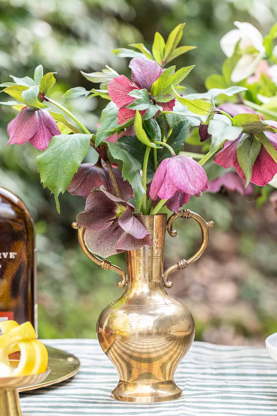 Flowers in an antique gold vase for a Kentucky Derby party