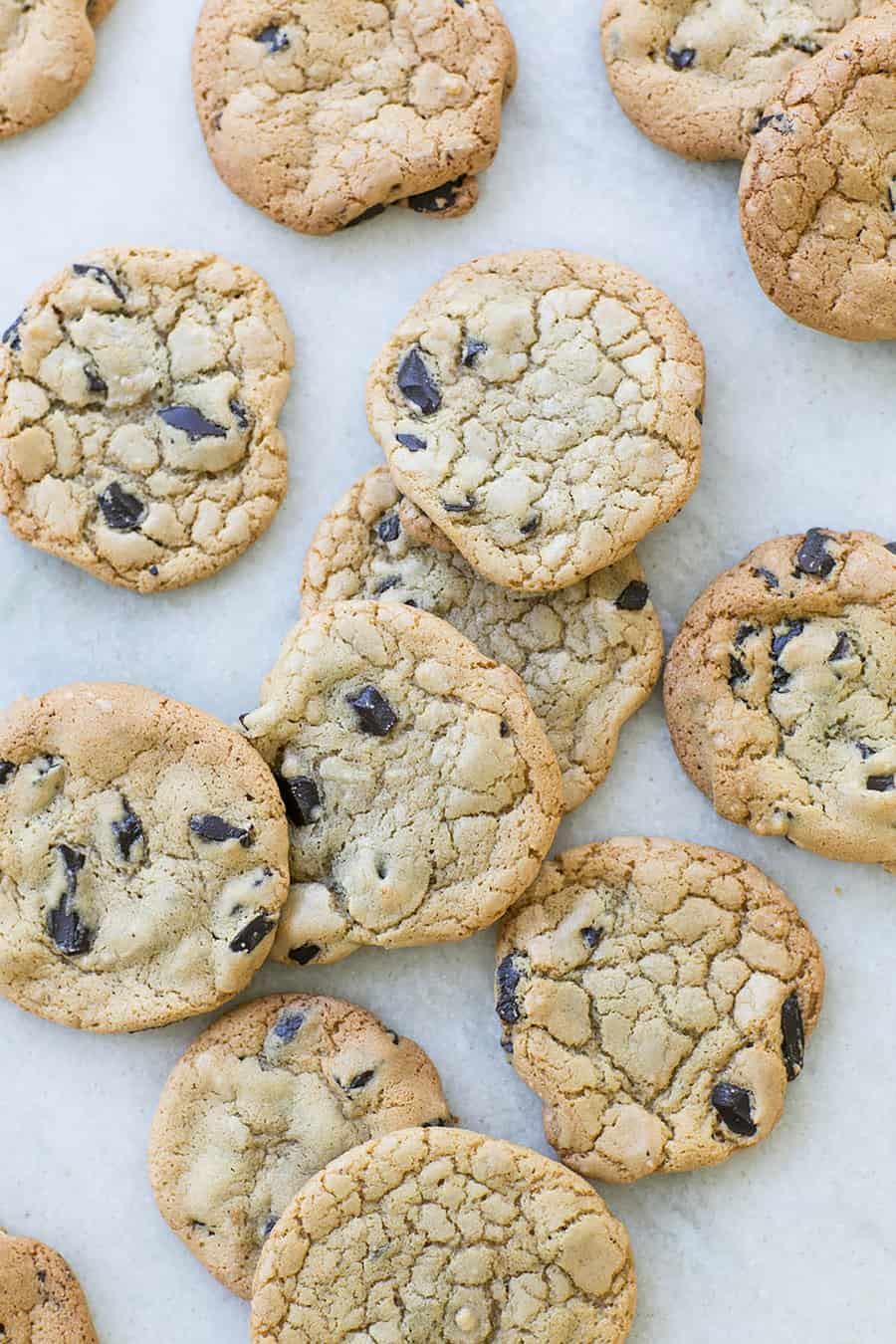 Butter-less chocolate chip cookies on parchment paper