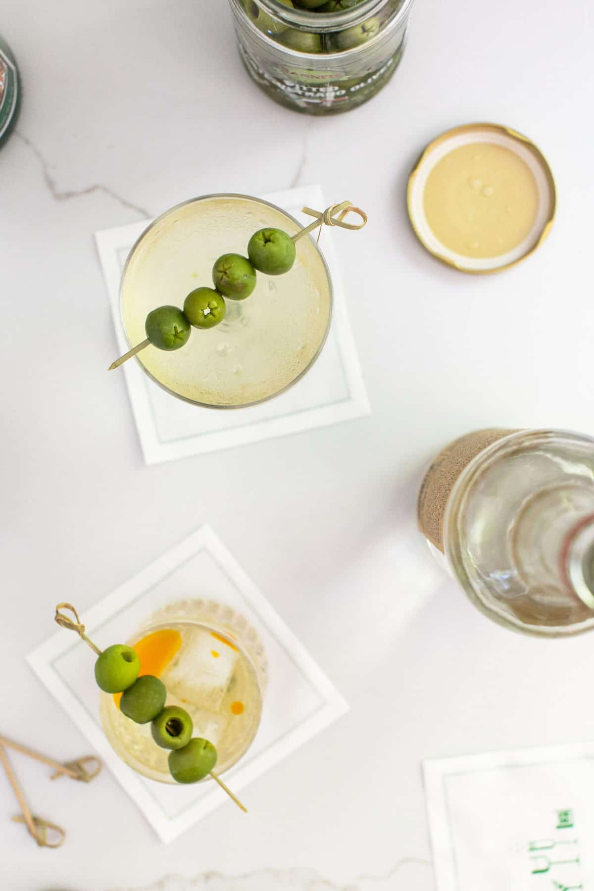 A classic dirty martini and a dirty martini made with tequila