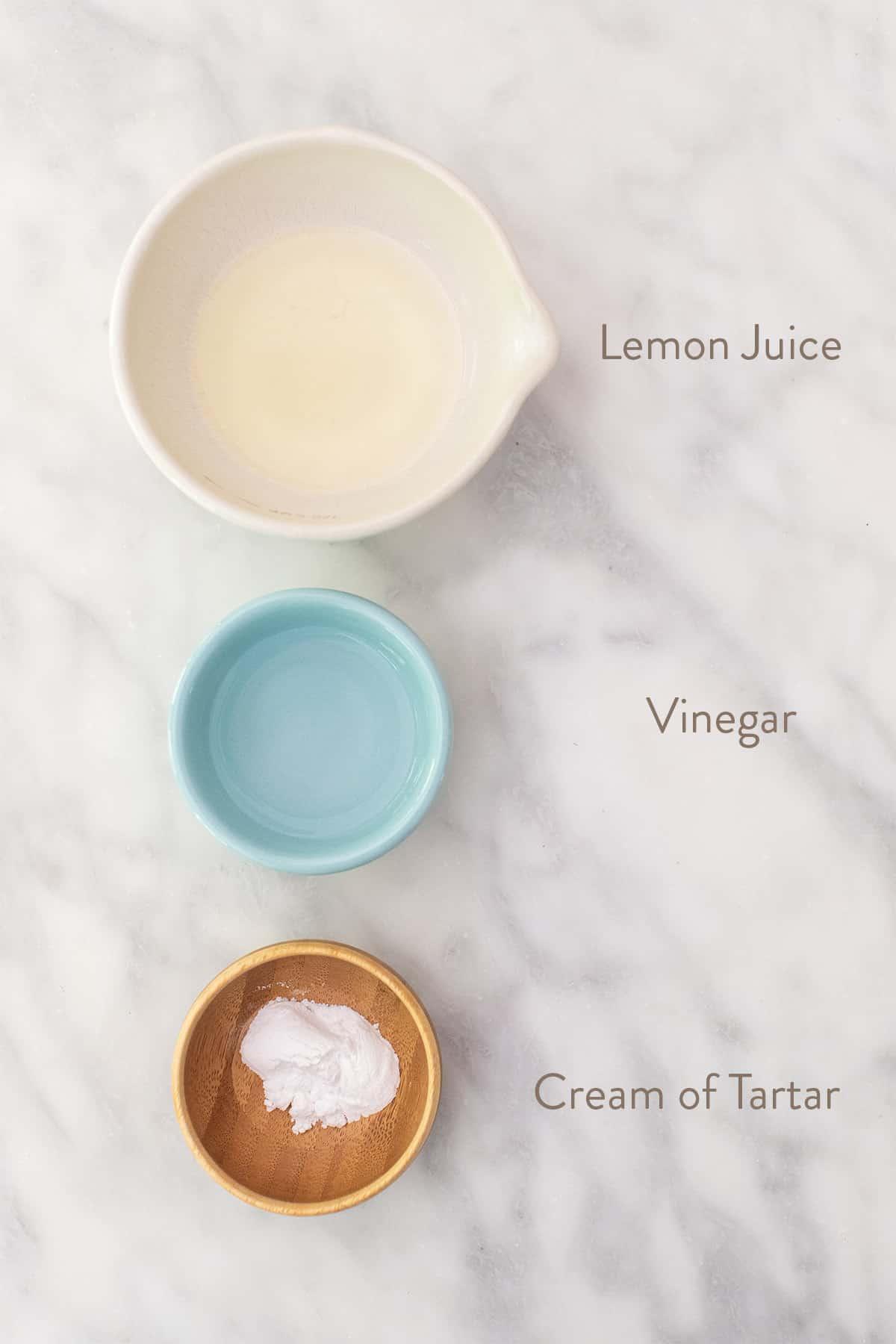 Lemon juice, vinegar and cream of tartar in small bowls.