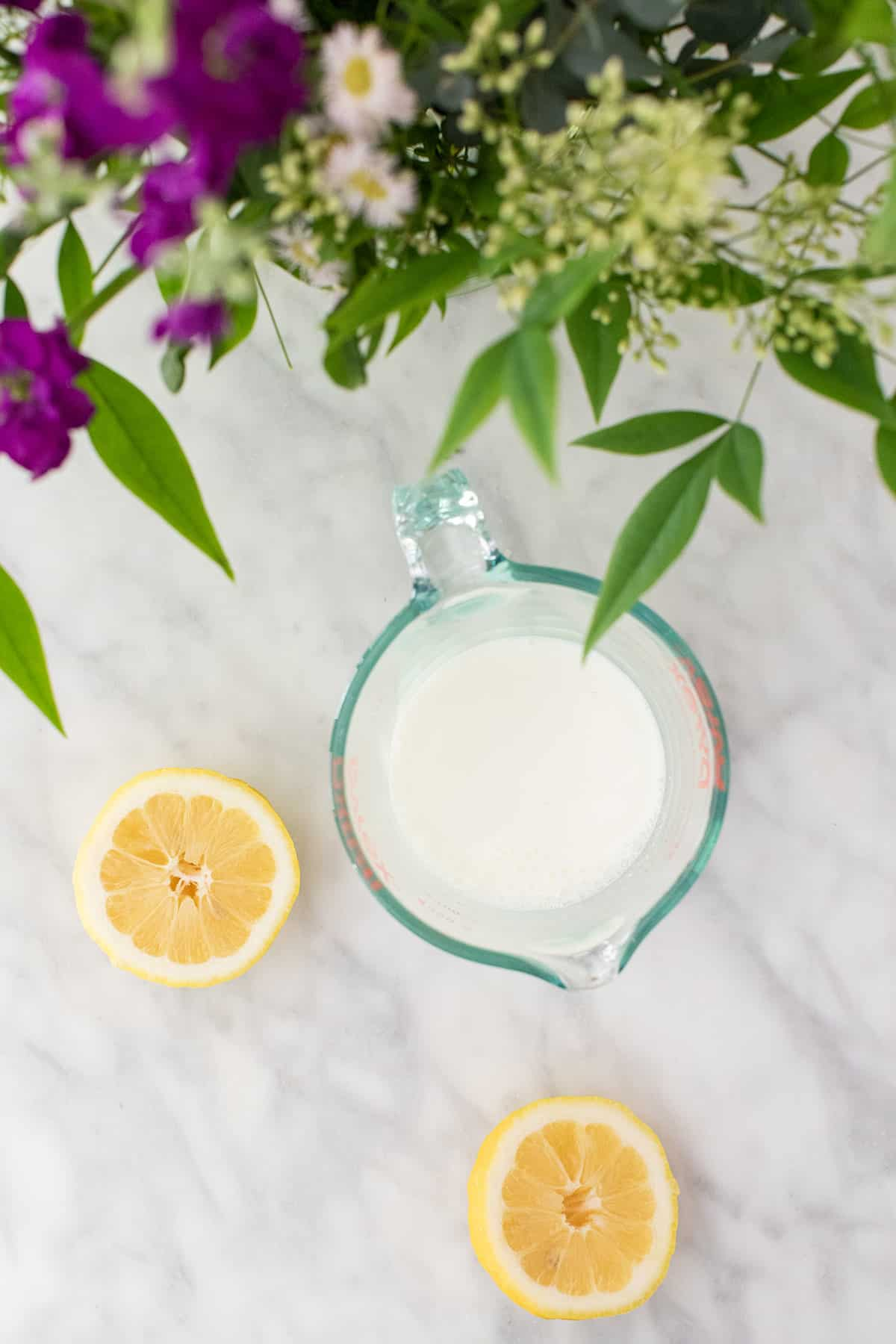 Milk and lemons on a table