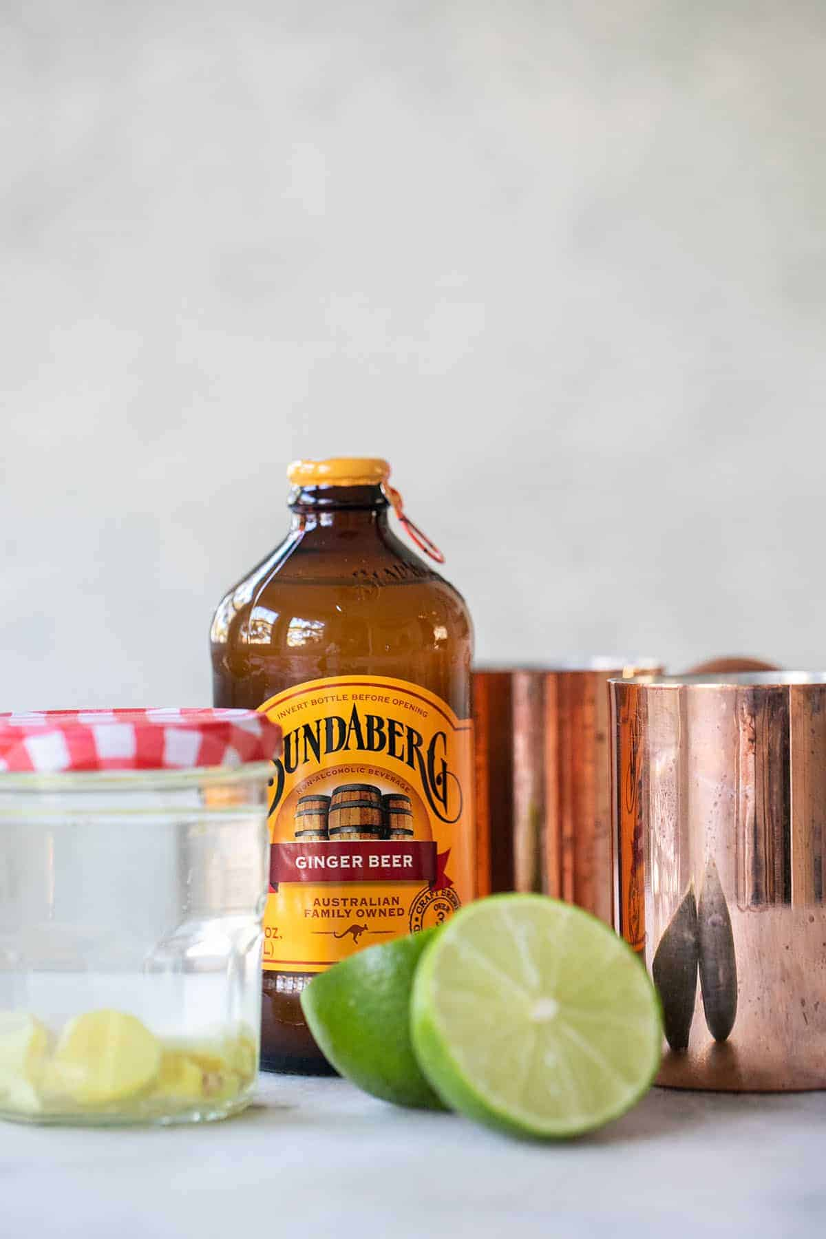 Ginger Beer with copper mugs and lime juice