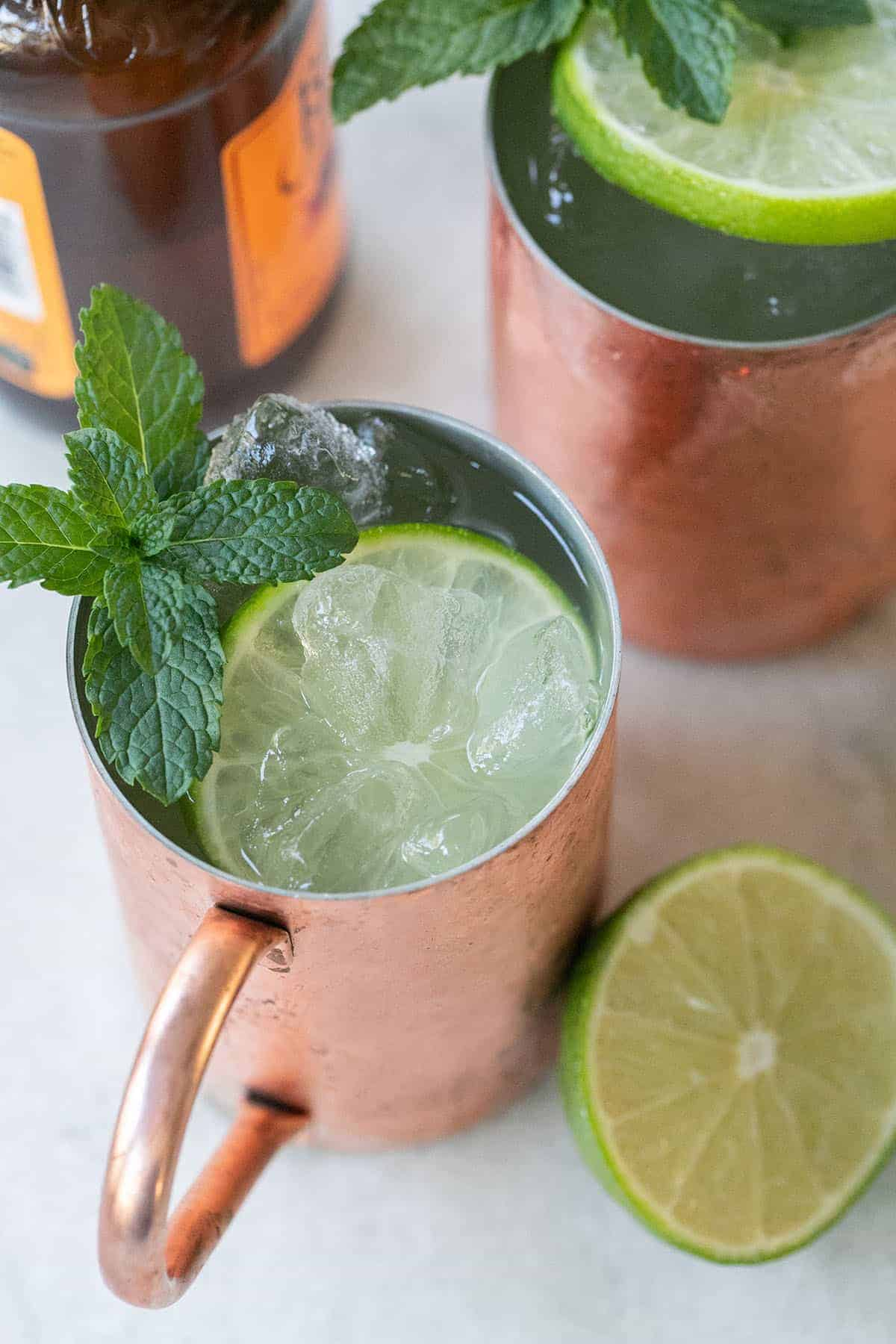 Moscow Mule in a copper mug with lime and mint.