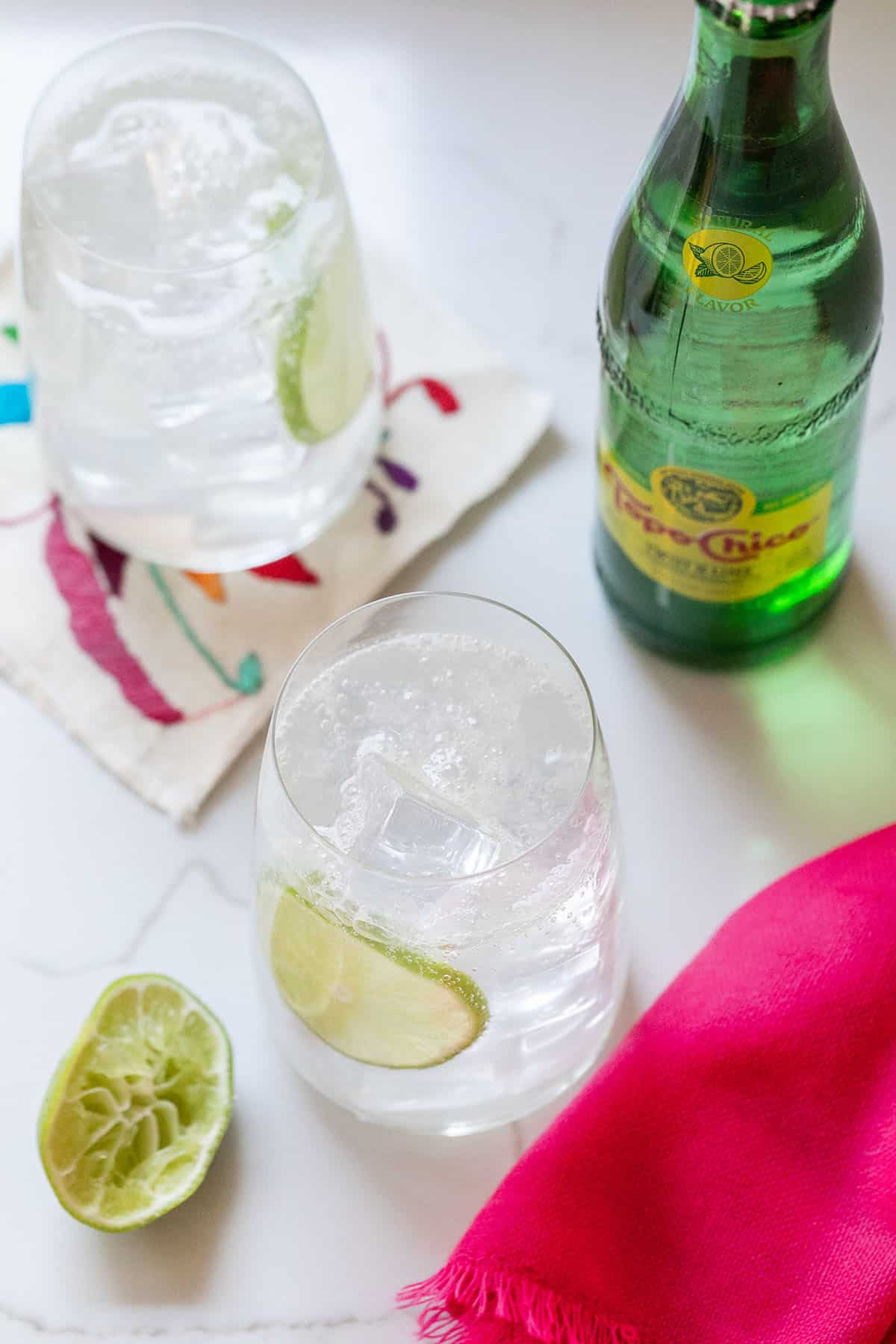 Two ranch waters in glasses that are cheap mixed drinks to make at home.