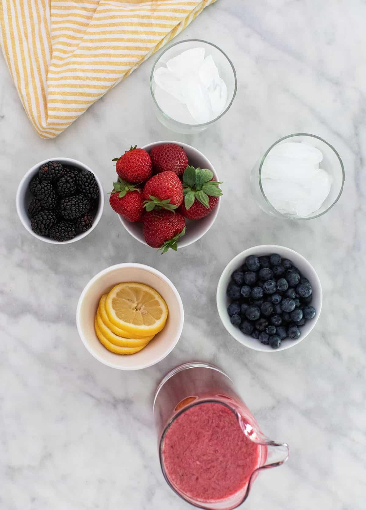 strawberries, lemons, blueberries and blackberries