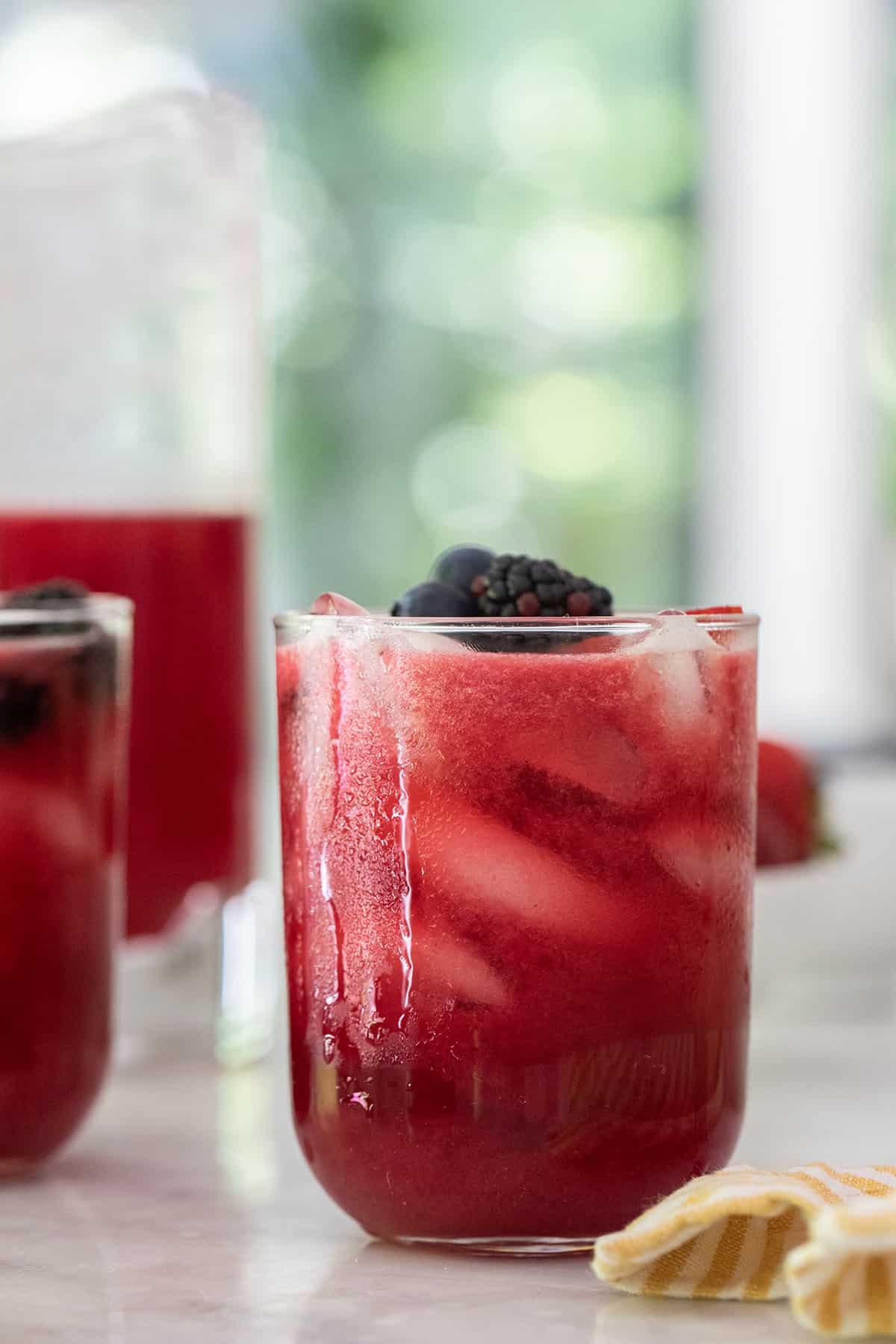 Iced berry lemonade recipe with blackberries, strawberries and blueberries.