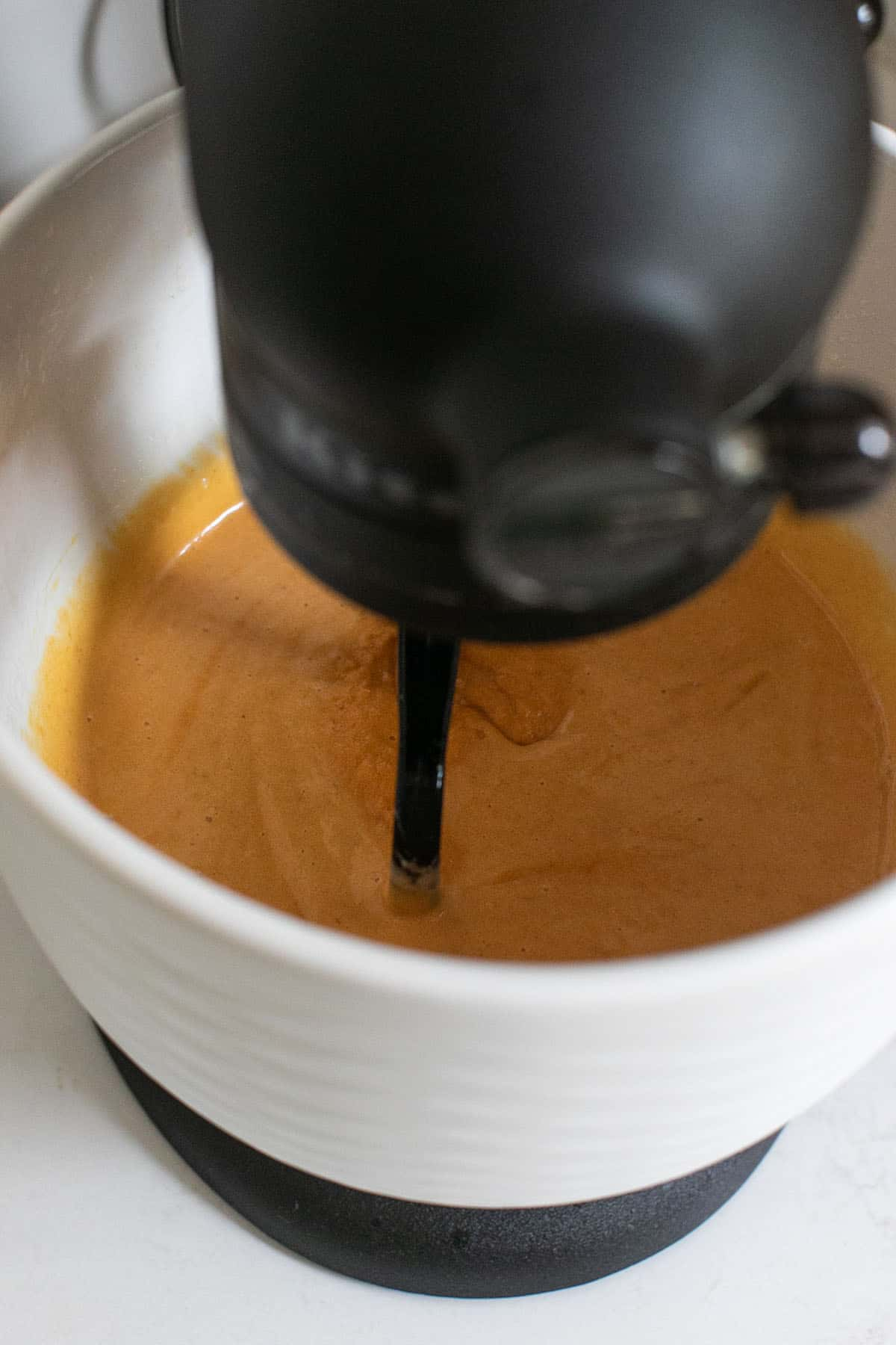 pumpkin bread batter in a mixing bowl
