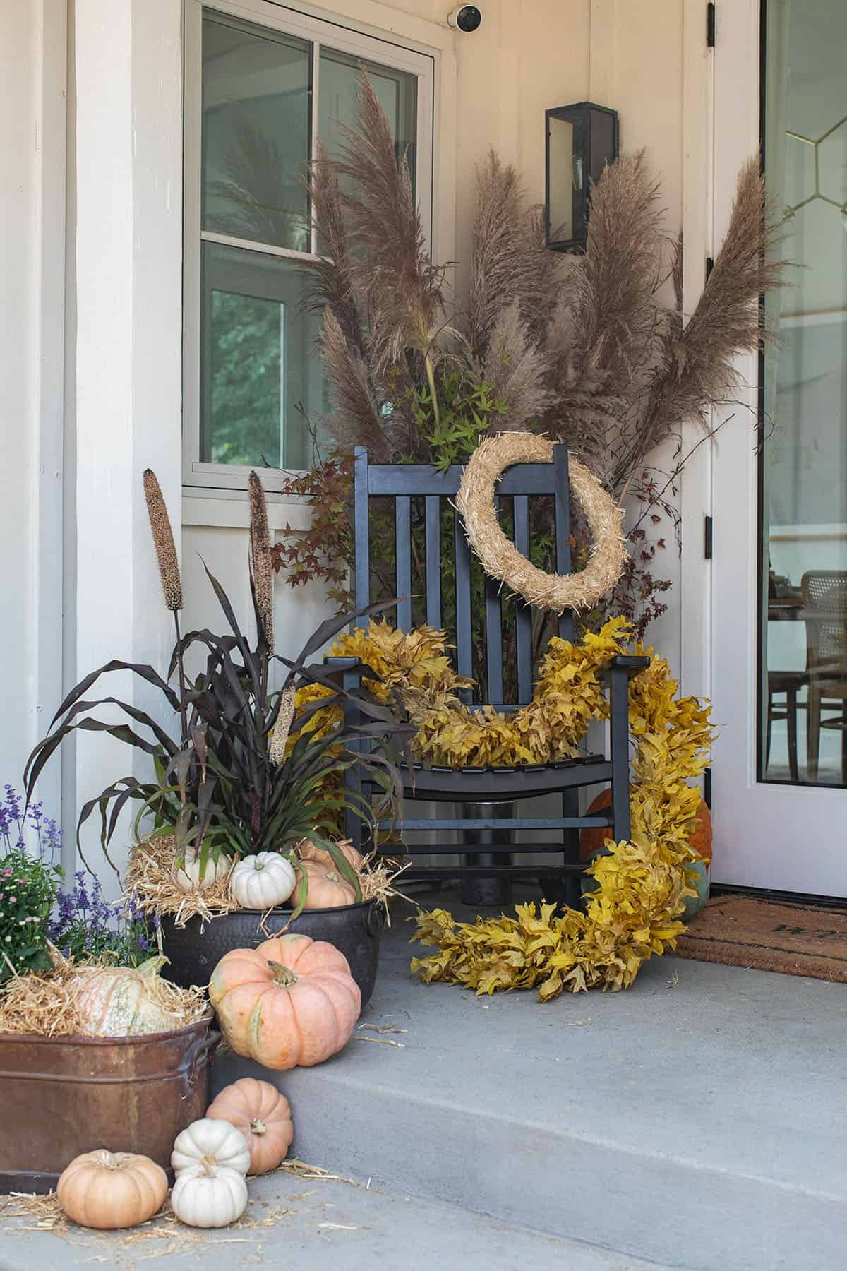 fall porch rocking chair and flowers