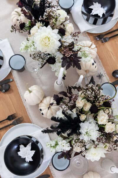 halloween party with blackened white flowers and ghost decorations