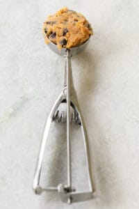 cookie scooper with pumpkin chocolate chip cookie dough