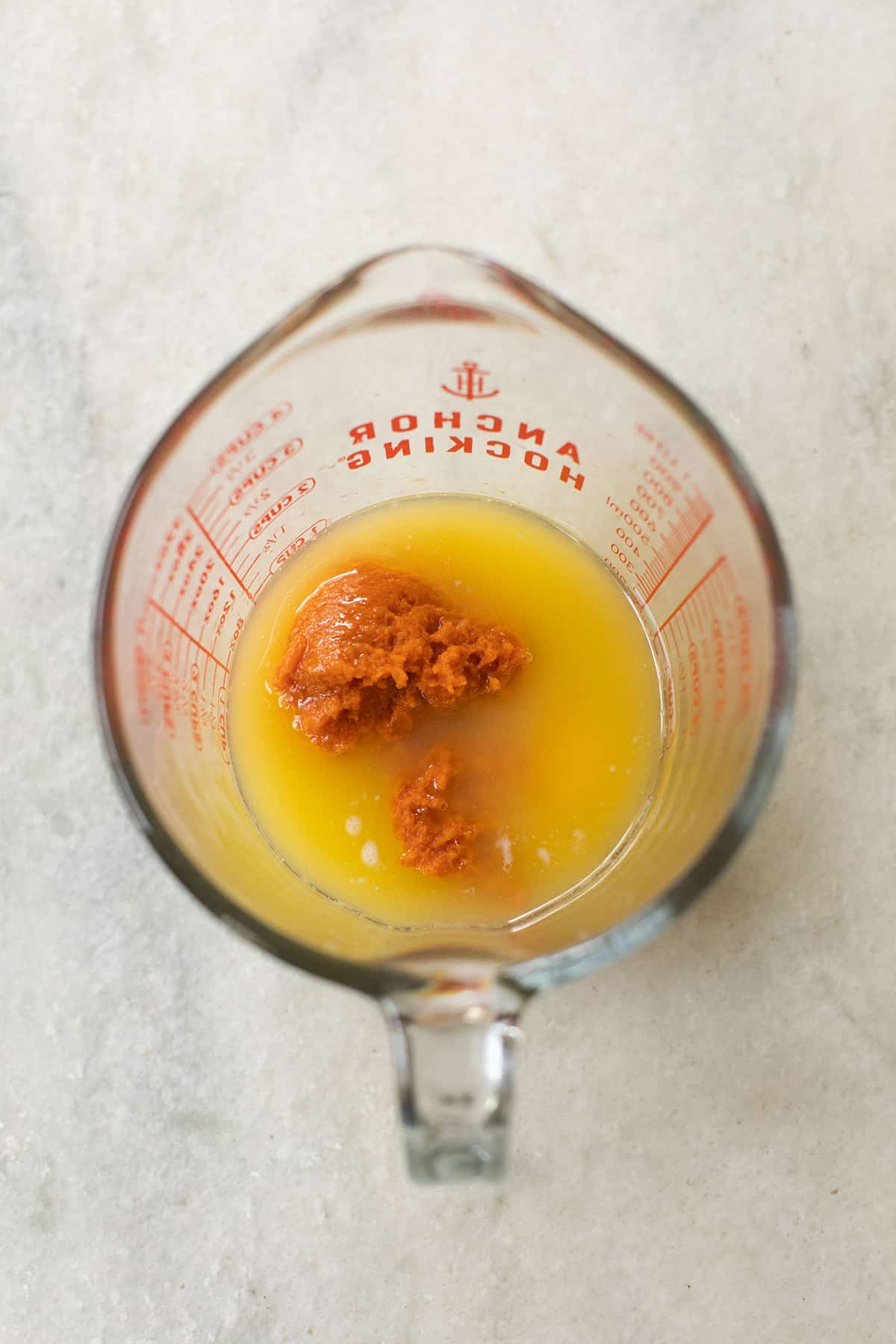 butter, pumpkin puree and egg in a liquid measuring cup